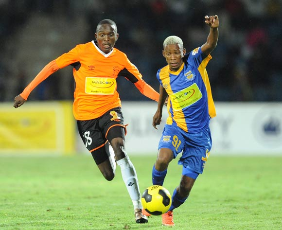 Lemogang Maswena of Orapa United and Kobamelo Kebaikanye of Township Rollers during the Mascom Top8 final at the Francistown Stadium in Botswana on 23 April 2016. Monirul Bhuiyan/Backpagepix
