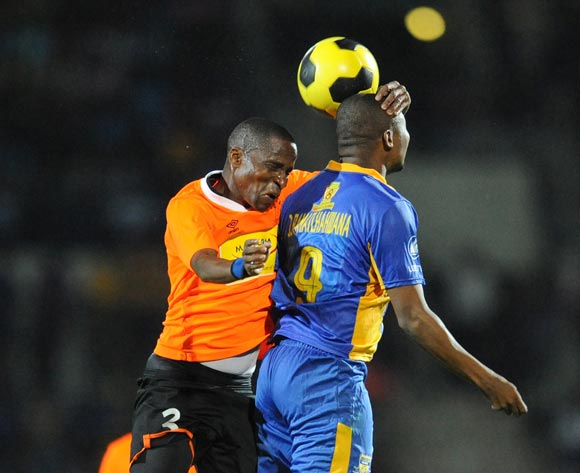 Patrick Motsepe of Orapa United and Jerome Ramatlhakwana of Township Rollers during the Mascom Top8 final at the Francistown Stadium in Botswana on 23 April 2016. Monirul Bhuiyan/Backpagepix