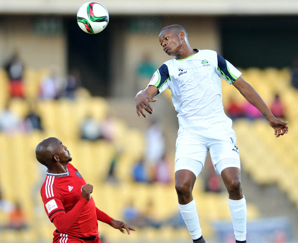 Patrick Phungwayo of Orlando Pirates challenged by Ndumiso Mabena of Platinum Stars during the Absa Premiership match between Platinum Stars and Orlando Pirates at the Royal Bafokeng Stadium in Rustenburg, South Africa on May 02, 2016 ©Samuel Shivambu/BackpagePix