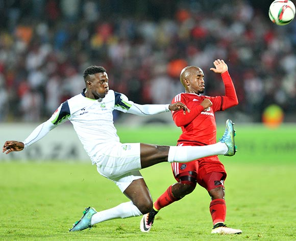 Patrick Phungwayo of Orlando Pirates tackled by Thamsanqa Gwabeni of Platinum Stars during the Absa Premiership match between Platinum Stars and Orlando Pirates at the Royal Bafokeng Stadium in Rustenburg, South Africa on May 02, 2016 ©Samuel Shivambu/BackpagePix