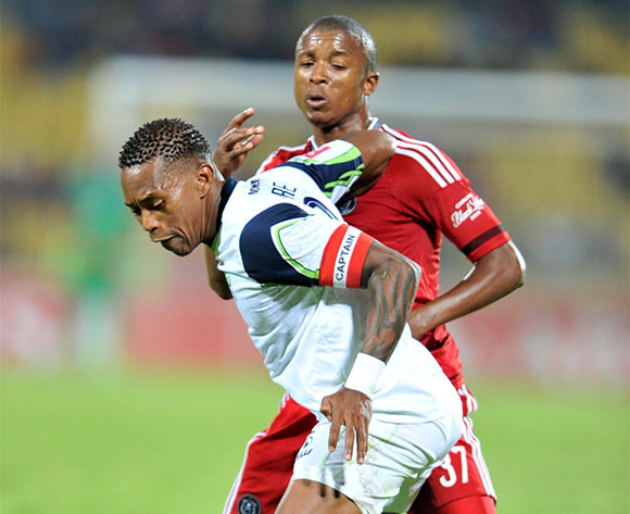 Vuyo Mere of Platinum Stars challenged by Luvuyo Memela of Orlando Pirates during the Absa Premiership match between Platinum Stars and Orlando Pirates at the Royal Bafokeng Stadium in Rustenburg, South Africa on May 02, 2016 ©Samuel Shivambu/BackpagePix
