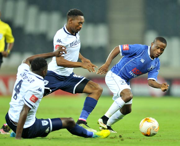 Lindokuhle Mbatha (r) of Black Aces challenged by Sibusiso Vilakazi (c) and Bongani Khumalo (l) of Bidvest Wits during the Absa Premiership match between Black Aces and Bidvest Wits at the Mbombela Stadium in Nelspruit, South Africa on May 03, 2016 ©Samuel Shivambu/BackpagePix