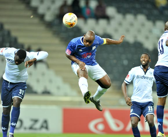 Collins Mbesuma of Black Aces challenged by Joaquim Lupeta, Buhle Mkhwanazi and S'fiso Hlanti of Bidvest Wits during the Absa Premiership match between Black Aces and Bidvest Wits at the Mbombela Stadium in Nelspruit, South Africa on May 03, 2016 ©Samuel Shivambu/BackpagePix