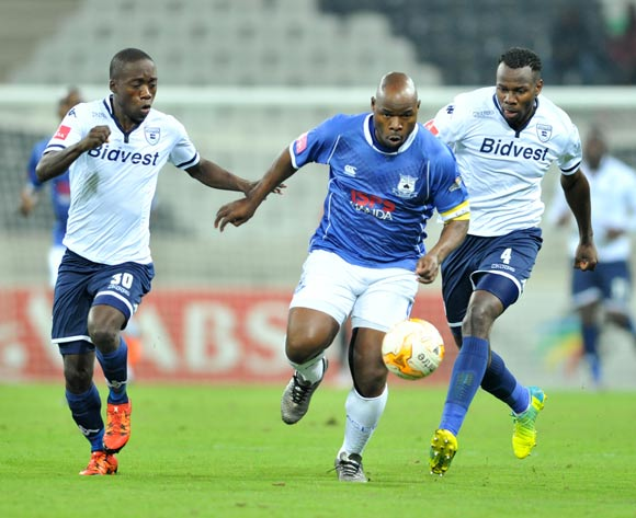Collins Mbesuma (c) of Black Aces challenged by Ben Motshwari (l) and Bongani Khumalo (r) of Bidvest Wits during the Absa Premiership match between Black Aces and Bidvest Wits at the Mbombela Stadium in Nelspruit, South Africa on May 03, 2016 ©Samuel Shivambu/BackpagePix