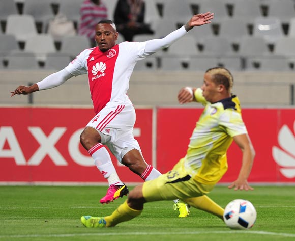Franklin Cale of Ajax Cape Town evades challenge from Cheslyn Jampies of Jomo Cosmos during the Absa Premiership 2015/16 football match between Ajax Cape Town and Jomo Cosmos at Cape Town Stadium, Cape Town on 4 May 2016 ©Chris Ricco/BackpagePix