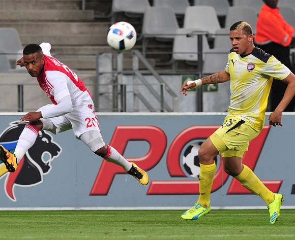 Erwin Isaacs of Ajax Cape Town swings a cross in past Cheslyn Jampies of Jomo Cosmos during the Absa Premiership 2015/16 football match between Ajax Cape Town and Jomo Cosmos at Cape Town Stadium, Cape Town on 4 May 2016 ©Chris Ricco/BackpagePix