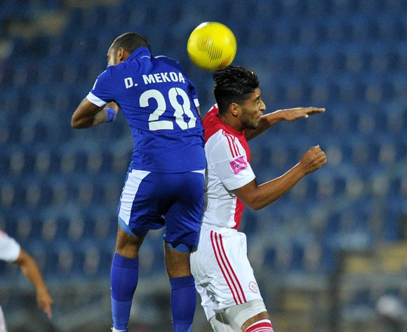 Travis Graham of Ajax Cape Town challenged by Deolin Mekoa of Martizburg United during the Absa Premiership 2015/16  match between Maritzburg United and Ajax Cape Town at Harry Gwala Stadium, Pietermaritzburg in Kwa-Zulu Natal South Africa on 11 May, 2016 ©Muzi Ntombela/BackpagePix