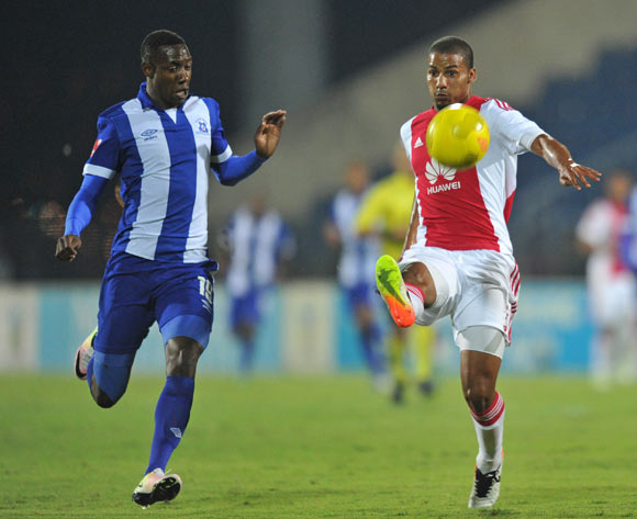 Rivaldo Coetzee of Ajax Cape Town clears ball from Evans Rusike of Maritzburg United during the Absa Premiership 2015/16  match between Maritzburg United and Ajax Cape Town at Harry Gwala Stadium, Pietermaritzburg in Kwa-Zulu Natal South Africa on 11 May, 2016 ©Muzi Ntombela/BackpagePix