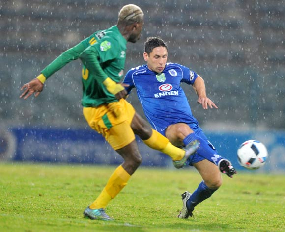 Dean Furman of Supersport United challenged by Lucky Mothwa of Baroka FC during the 2016 Nedbank Cup Semi-final football match between Supersport United and Baroka FC at the Lucas Moripe Stadium in Pretoria, South Africa on May 14, 2016 ©Samuel Shivambu/BackpagePix