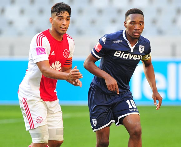 Sibusiso Vilakazi of Bidvest Wits is challenged by Travis Graham of Ajax Cape Town during the Absa Premiership 2015/16 game between Ajax Cape Town and Bidvest Wits at Cape Town Stadium on 21 May 2016 ©Ryan Wilkisky/BackpagePix