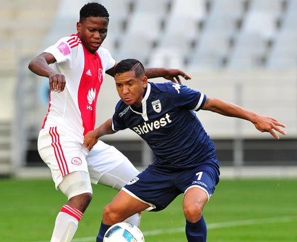 Daine Klate of Bidvest Wits is challenged by Ndiviwe Mdabuka of Ajax Cape Town during the Absa Premiership 2015/16 game between Ajax Cape Town and Bidvest Wits at Cape Town Stadium on 21 May 2016 ©Ryan Wilkisky/BackpagePix
