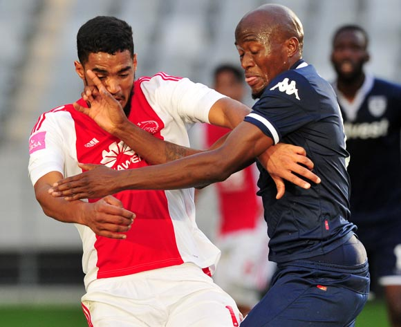 Tashreeq Morris of Ajax Cape Town and Sifiso Hlanti of Bidvest Wits tussle for possession during the Absa Premiership 2015/16 game between Ajax Cape Town and Bidvest Wits at Cape Town Stadium on 21 May 2016 ©Ryan Wilkisky/BackpagePix