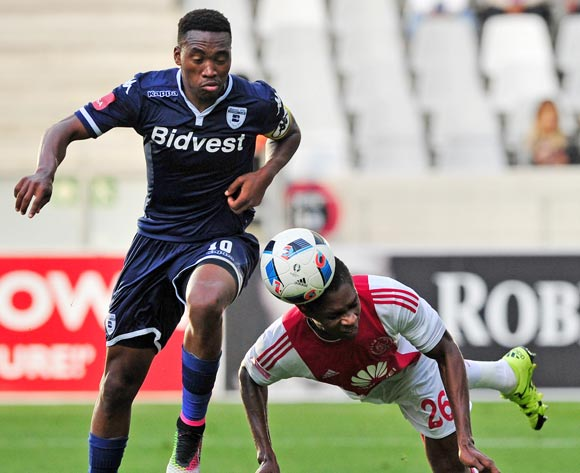 Lawrence Lartey of Ajax Cape Town clears the ball ahead of Sibusiso Vilakazi of Bidvest Wits during the Absa Premiership 2015/16 game between Ajax Cape Town and Bidvest Wits at Cape Town Stadium on 21 May 2016 ©Ryan Wilkisky/BackpagePix