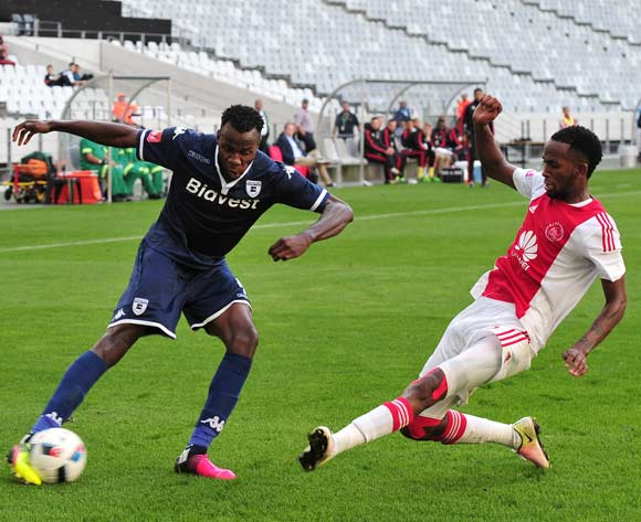 Bongani Khumalo of Bidets Wits is challenged by Mosa Lebusa of Ajax Cape Town during the Absa Premiership 2015/16 game between Ajax Cape Town and Bidvest Wits at Cape Town Stadium on 21 May 2016 ©Ryan Wilkisky/BackpagePix