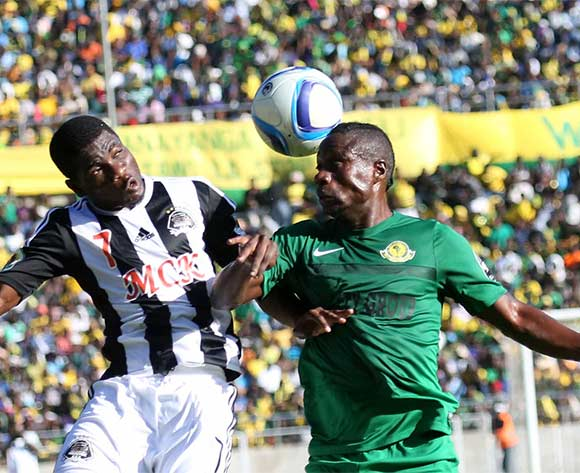 Roger Claver Assale of TP Mazembe (l) is challenged by Mbuyu Twite of Young Africans during the CAF Confederation Cup football match between Young Africans and TP Mazembe at the National Stadium in Dar es Salaam, Tanzania on 28 June 2016 @BackpagePix