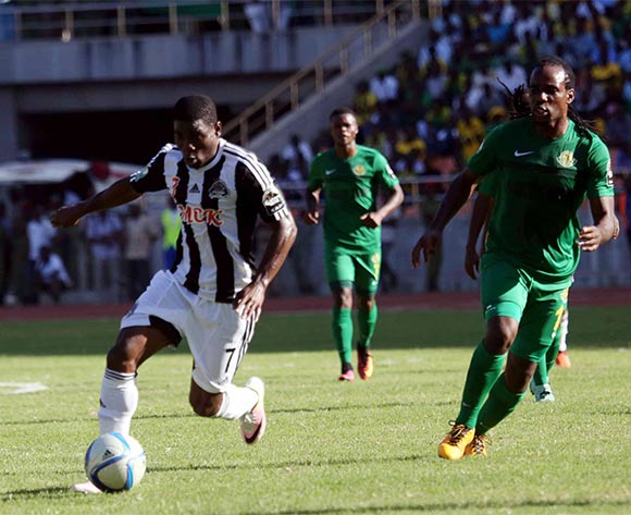 Roger Claver Assale, TP Mazembe (l) is challenged by  Taban Kamusoko of Young Africans during the CAF Confederation Cup football match between Young Africans and TP Mazembe at the National Stadium in Dar es Salaam, Tanzania on 28 June 2016 ©BackpagePix