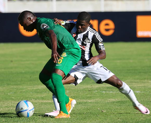 Mbui Twite of Young Africans FC (l) fights for the ball with Roger Claver Assale of TP Mazembe  (r) during the CAF Confederation Cup football match between Young Africans and TP Mazembe at the National Stadium in Dar es Salaam, Tanzania on 28 June 2016 ©BackpagePix