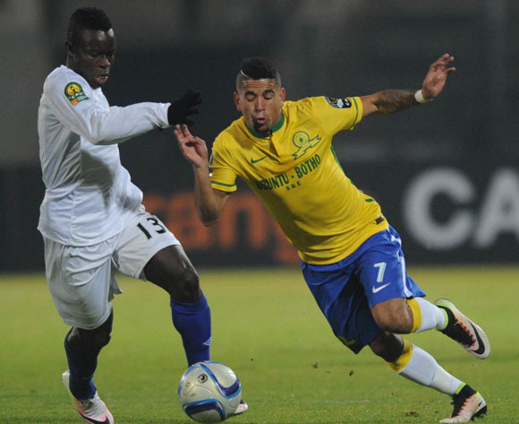 Keagan Dolly of Mamelodi Sundowns (right) is challenged by Daniel Etor of Enyimba  during the CAF Champions League match