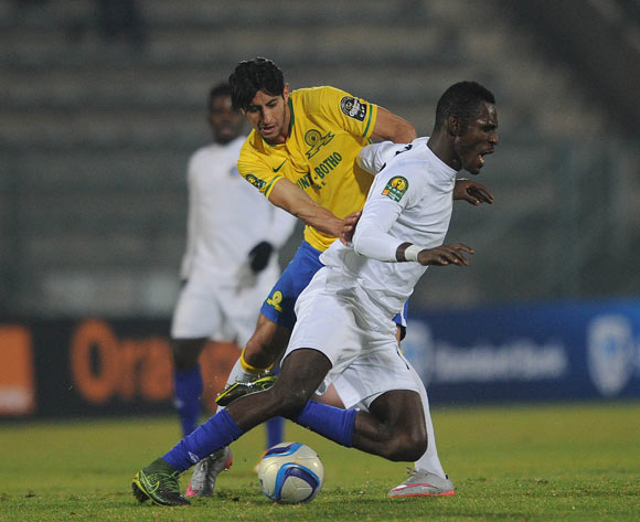 Leonardo Castro of Mamelodi Sundowns tackles Oahimijie Kelly of Enyimba  during the CAF Champions League match Mamelodi Sundowns and  Enyimba on 29 June 2016 at Lucas Moripe Stadium  Pic Sydney Mahlangu/ BackpagePix