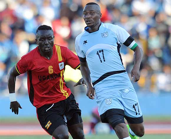 BOTSWANA, Francistown, Joel Mogorosi of Botswana National team Zebras  and  Mawejje Tonny of Uganda  vie for the ball during the AFCON 2017 qualifying match at the Francistown Stadium in Botswana on 4 June 2016. MONIRUL BHUIYAN/Backpagepix