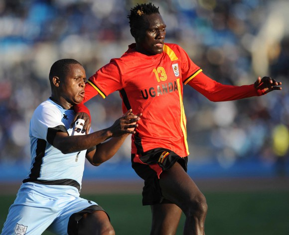 BOTSWANA, Francistown, Kabelo Seakanyeng of Botswana National team Zebras  and Olhaya Joseph Benson  of Uganda  vie for the ball during the AFCON 2017 qualifying match at the Francistown Stadium in Botswana on 4 June 2016.  MONIRUL BHUIYAN/Backpagepix