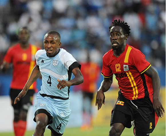 BOTSWANA, Francistown, Onkabetse Makgantai of Botswana National team Zebras  and  Iguma Denis of Uganda  vie for the ball during the AFCON 2017 qualifying match at the Francistown Stadium in Botswana on 4 June 2016.  MONIRUL BHUIYAN/Backpagepix