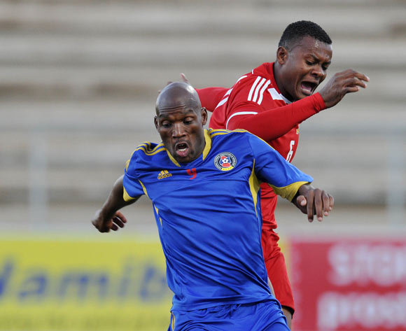 Sabelo Ndzinisa of Swaziland challenged by Benoit Marie of Seychelles during the 2016 Cosafa Cup match between Swaziland and Seychelles at Sam Nujoma Stadium in Windhoek Namibia on 13 June, 2016 ©Muzi Ntombela/BackpagePix