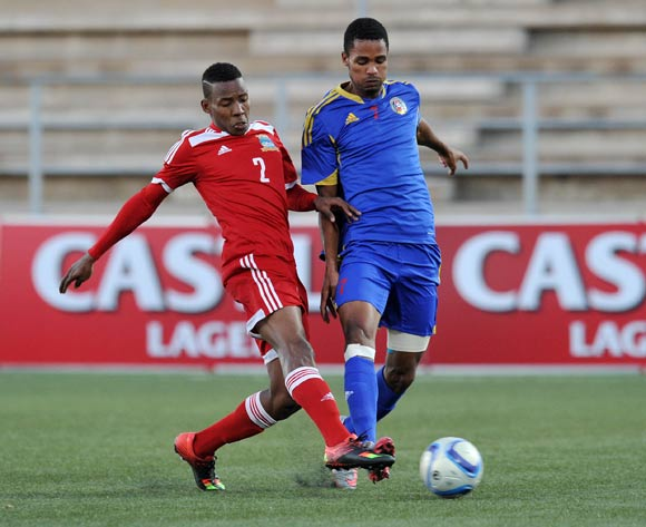 Felix Badenhorst of Swaziland tackled by Yanick Manoo of Seychelles during the 2016 Cosafa Cup match between Swaziland and Seychelles at Sam Nujoma Stadium in Windhoek Namibia on 13 June, 2016 ©Muzi Ntombela/BackpagePix
