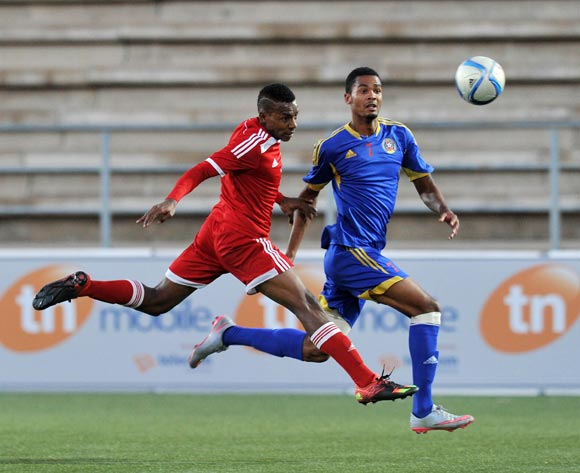 Yanick Manoo of Seychelles clears ball from Felix Badenhorst of Swaziland (right) during the 2016 Cosafa Cup match between Swaziland and Seychelles at Sam Nujoma Stadium in Windhoek Namibia on 13 June, 2016 ©Muzi Ntombela/BackpagePix