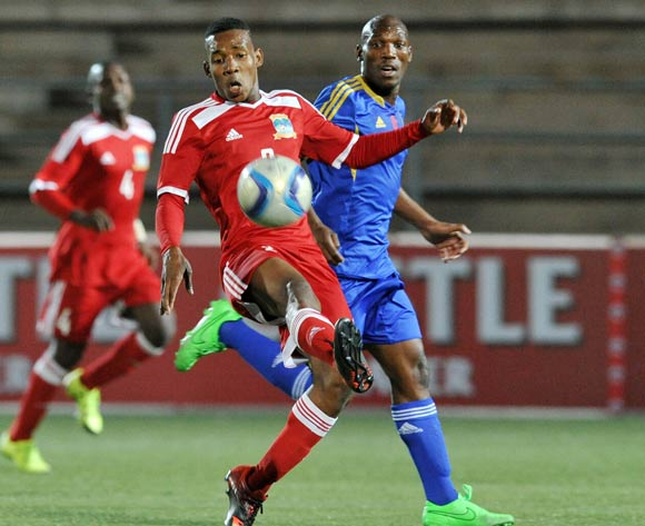 Yanick Manoo of Seychelles challenged by Sabelo Ndzinisa of Swaziland during the 2016 Cosafa Cup match between Swaziland and Seychelles at Sam Nujoma Stadium in Windhoek Namibia on 13 June, 2016 ©Muzi Ntombela/BackpagePix