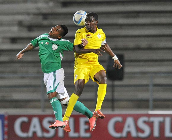 Danny Phiri of Zimbabwe challenged by Ando Manoelantsoa of Madagascar during the 2016 Cosafa Cup match between Madagascar and Zimbabwe at Sam Nujoma Stadium in Windhoek Namibia on 13 June, 2016 ©Muzi Ntombela/BackpagePix