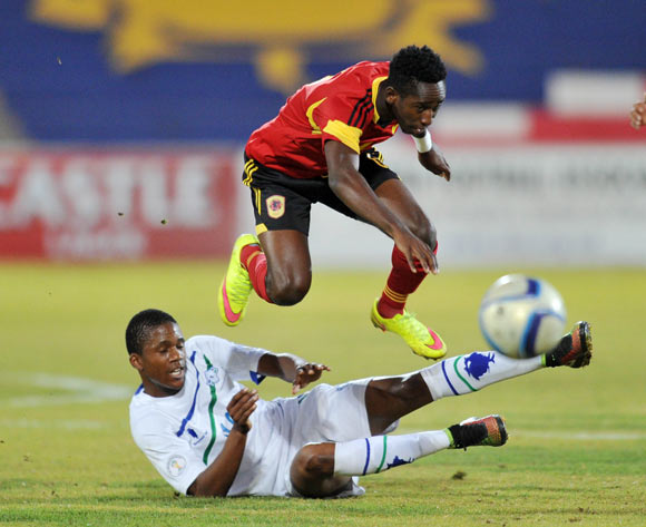 Seturumane Tsepo of Lesotho fouled by Fernando Jacinto Quissanga of Angola during the 2016 Cosafa Cup match between Angola and Lesotho at Independence Stadium in Windhoek Namibia on 14 June, 2016 ©Muzi Ntombela/BackpagePix