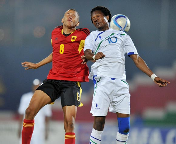 Mabuti Potloane of Lesotho challenges Carlos Guimaraes Do Carmo of Angola during the 2016 Cosafa Cup match between Angola and Lesotho at Independence Stadium in Windhoek Namibia on 14 June, 2016 ©Muzi Ntombela/BackpagePix