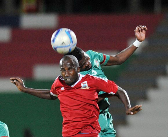 Louis Guiyano Chiffone of Mauritius challenged by Francis Mulimbika of Malawi during the 2016 Cosafa Cup match between Mauritius and Malawi at Independence Stadium in Windhoek Namibia on 14 June, 2016 ©Muzi Ntombela/BackpagePix