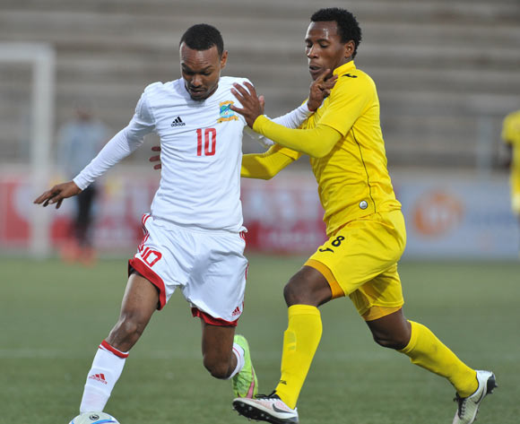 Achille Henriette of Seychelles challenged by Nqobizitha Masuku of Zimbabwe  during the 2016 Cosafa Cup match between Zimbabwe and Seychelles at Sam Nujoma Stadium in Windhoek Namibia on 15 June, 2016 ©Muzi Ntombela/BackpagePix