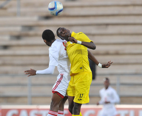 Teenage Hadebe of Zimbabwe challenged by Colin Bibi of Seychelles during the 2016 Cosafa Cup match between Zimbabwe and Seychelles at Sam Nujoma Stadium in Windhoek Namibia on 15 June, 2016 ©Muzi Ntombela/BackpagePix