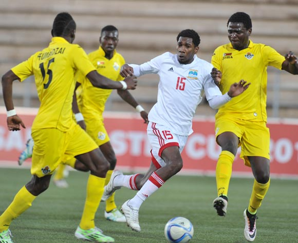 Tamboo Elijah of Seychelles challenged by Ronald Pfumbidzai (l) and Lawrence Mhlanga of Zimbabwe during the 2016 Cosafa Cup match between Zimbabwe and Seychelles at Sam Nujoma Stadium in Windhoek Namibia on 15 June, 2016 ©Muzi Ntombela/BackpagePix