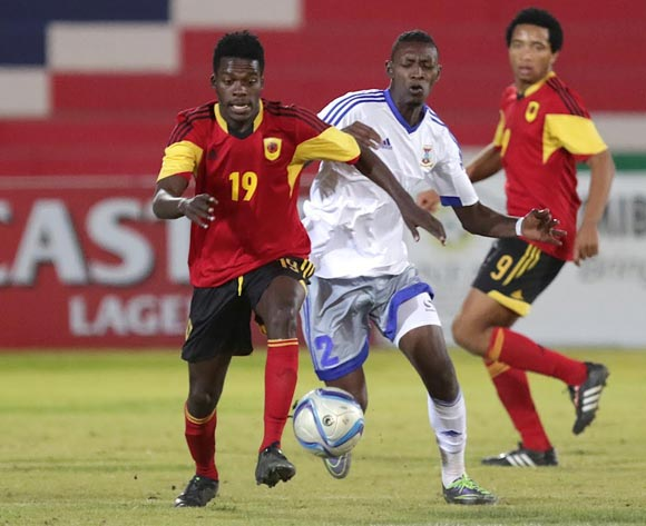 Paulino Nguendelamba of Angola shields the ball from Laval Rungassamy of Mauritius during their Cosafa Castle Cup match in Windhoek on 16 June 2016. Photo: BackpagePix