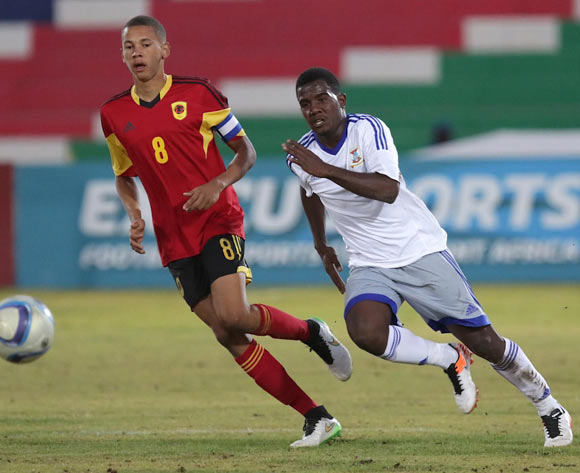 han Pierre Bru of Mauritius passes the ball while Zinadine Catraio (left) of Angola looks on during their Cosafa Castle Cup match in Windhoek on 16 June 2016. Photo: BackpagePix