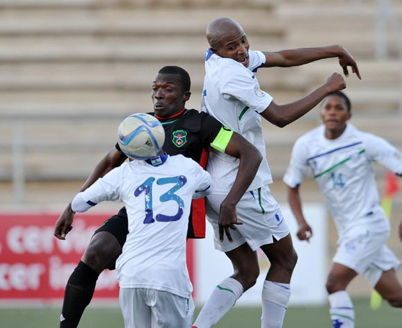 Chiukepo Pulli Msowoya of Malawi challenged by Jane Thaba-Ntso of Lesotho during the 2016 Cosafa Cup match between Malawi and Lesotho at Sam Nujoma Stadium in Windhoek Namibia on 16 June, 2016 ©Muzi Ntombela/BackpagePix