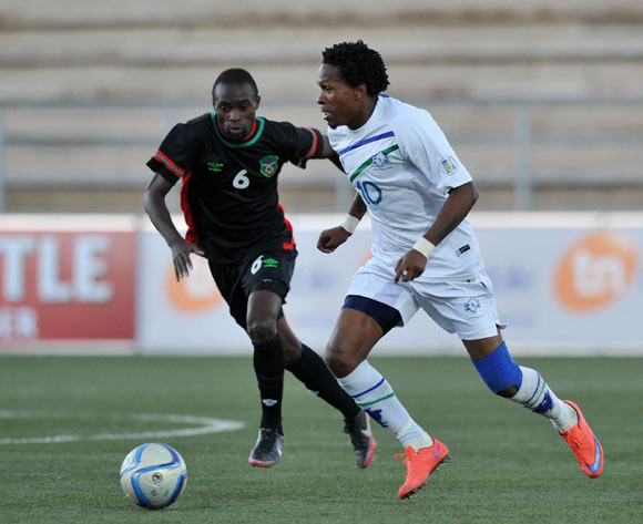 Mabuti Potloane of Lesotho challenged by Rafiq Namwera of Malawi during the 2016 Cosafa Cup match between Malawi and Lesotho at Sam Nujoma Stadium in Windhoek Namibia on 16 June, 2016 ©Muzi Ntombela/BackpagePix