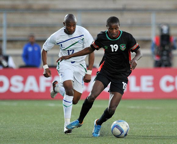 Isaac Kaliati of Malawi challenged by Jeremea Kamela of Lesotho during the 2016 Cosafa Cup match between Malawi and Lesotho at Sam Nujoma Stadium in Windhoek Namibia on 16 June, 2016 ©Muzi Ntombela/BackpagePix