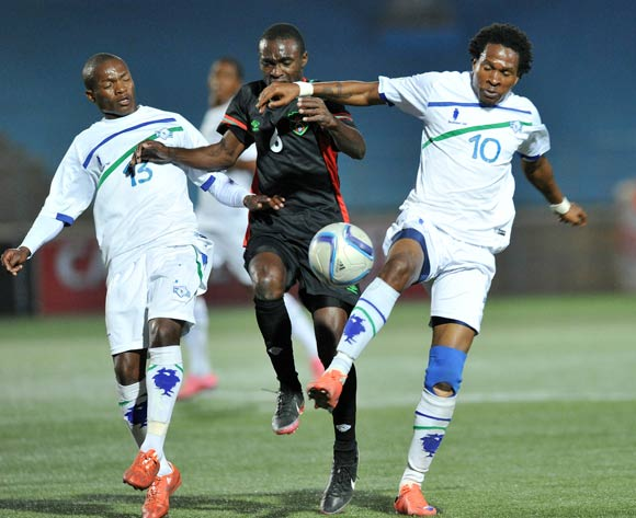 Rafiq Namwera of Malawi challenged by Mabuti Potloane (r) and Jane Thaba-Ntso of Lesotho during the 2016 Cosafa Cup match between Malawi and Lesotho at Sam Nujoma Stadium in Windhoek Namibia on 16 June, 2016 ©Muzi Ntombela/BackpagePix