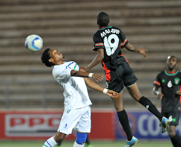 Mabuti Potloane of Lesotho challenged by Isaac Kaliati of Malawi during the 2016 Cosafa Cup match between Malawi and Lesotho at Sam Nujoma Stadium in Windhoek Namibia on 16 June, 2016 ©Muzi Ntombela/BackpagePix