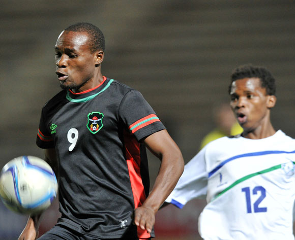 Muhammad Sulumba of Malawi challenged by Kefuoe Mahula of Lesotho during the 2016 Cosafa Cup match between Malawi and Lesotho at Sam Nujoma Stadium in Windhoek Namibia on 16 June, 2016 ©Muzi Ntombela/BackpagePix