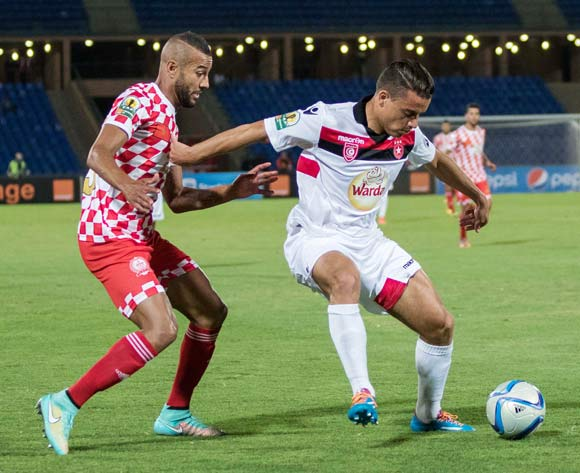 Ghazi Abderrazak of Etoile (r) shields ball from Abdelouahed Chakhsi of Kawkab (l) during the CAF Confederation Cup match between Kawkab Marrakech and  Etoile Sahel in Marrakech, Morocco on 17 June  2016 ©BackpagePix