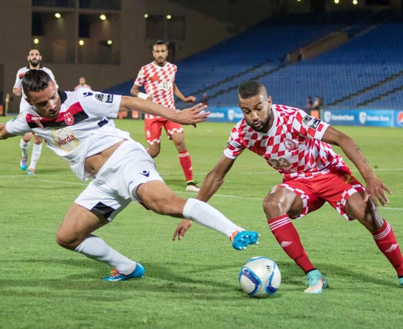 Ghazi Abderrazak of Etoile (l) shields ball from Abdelouahed Chakhsi of Kawkab (r) during the CAF Confederation Cup match between Kawkab Marrakech and  Etoile Sahel in Marrakech, Morocco on 17 June  2016 ©BackpagePix