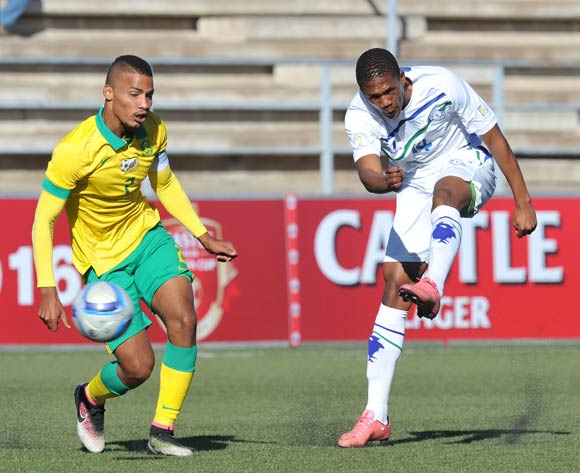 Seturumane Tsepo of Lesotho takes a shot at goal while challenged by Rivaldo Coetzee of South Africa during the 2016 Cosafa Cup Quarterfinals match between South Africa and Lesotho at Sam Nujoma Stadium in Windhoek Namibia on 18 June, 2016 ©Muzi Ntombela/BackpagePix