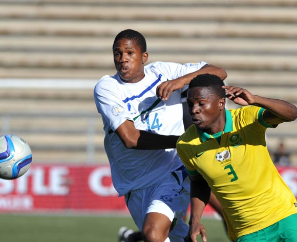 Mbhazima Rikhotso of South Africa shields ball from Seturumane Tsepo of Lesotho during the 2016 Cosafa Cup Quarterfinals match between South Africa and Lesotho at Sam Nujoma Stadium in Windhoek Namibia on 18 June, 2016 ©Muzi Ntombela/BackpagePix