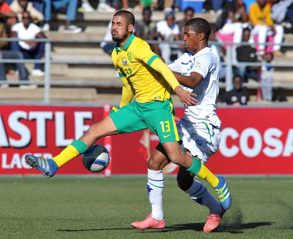 Abbubaker Mobara of South Africa clears ball from Seturumane Tsepo of Lesotho during the 2016 Cosafa Cup Quarterfinals match between South Africa and Lesotho at Sam Nujoma Stadium in Windhoek Namibia on 18 June, 2016 ©Muzi Ntombela/BackpagePix